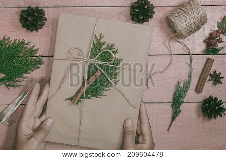 Creative Hobby. Gift Wrapping. Packaging Modern Christmas Present Boxes In Stylish Craft Paper With