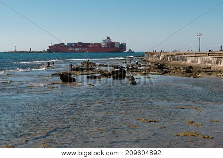 Livorno, Italy - july 2015: Large Red Container Ship Near Coastline