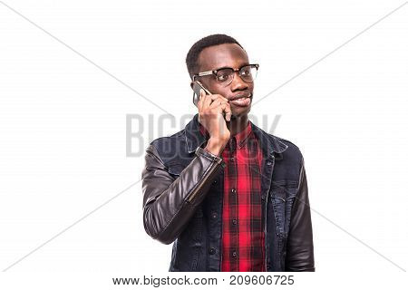 Young African American Man Making A Phone Call On Her Smartphone On White