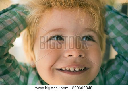 Interested Boy Face. Brown Eyes And Blond Hair Of Adorable Little Kid. Positive And Scincere Emotion