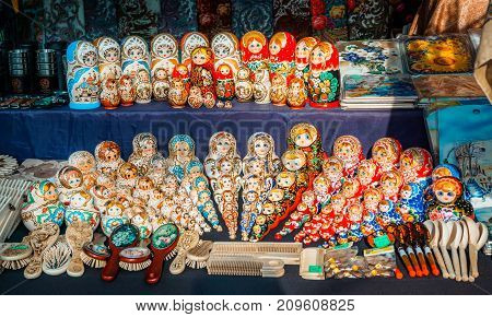 Uglich, Russia - 20 July 2017: Colorful Russian nesting dolls at the market. Russian souvenirs