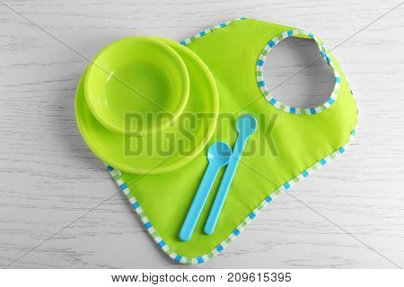 Set with bright baby dishware on table