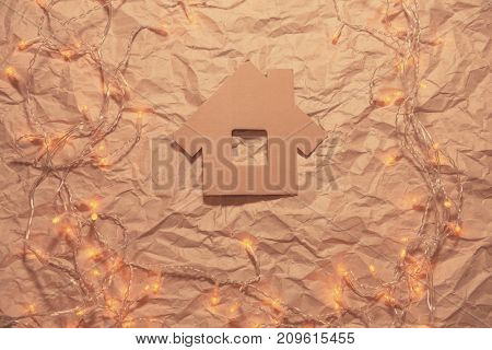House  on crumpled  kraft paper