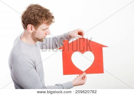 Young Man In Love With Paper House.