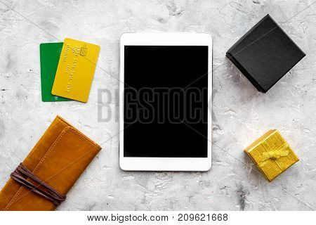 christmas 2018 sales for online gift buying with credit card and tablet on stone desk background top view mock-up