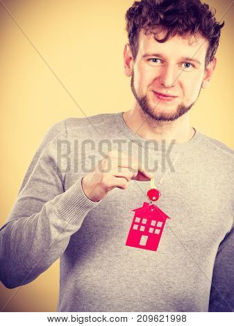 Man Holding Key With House Symbol