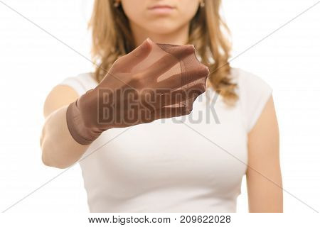 Female hands with nylon socks den on a white background isolation
