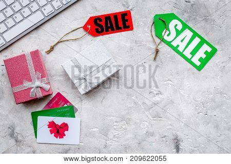 christmas 2018 sales for online gift buying with credit card on stone desk background top view mock-up