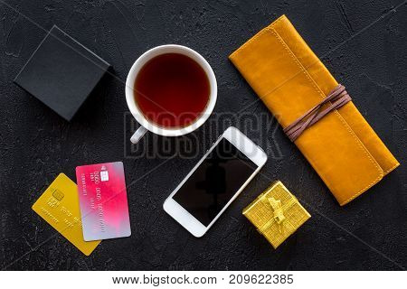 order new year 2018 present with credit card and phone on dark black table background top view mock up