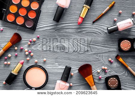 Cosmetics set with beige and nude tones for natural makeup on grey wooden woman table background top view mock up