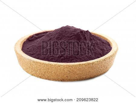 Acai powder in cork bowl, isolated on white