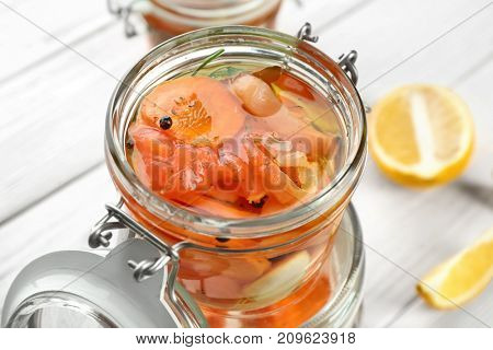 Jar with delicious marinated salmon, closeup