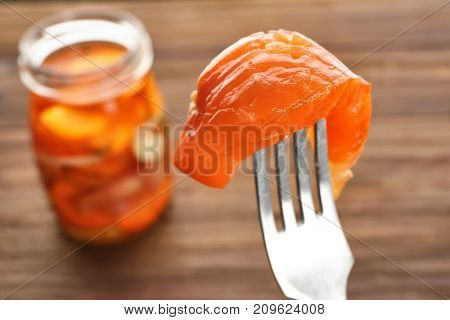 Fork with delicious marinated salmon on blurred background