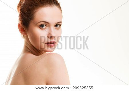 Beauty of body care showering clean and fresh skin concept. Naked woman in towel sitting on floor after bathing. Studio shot isolated