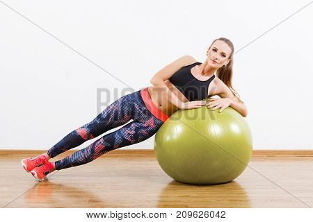 Fit Girl Doing Physical Exercises With Fitball At Gym