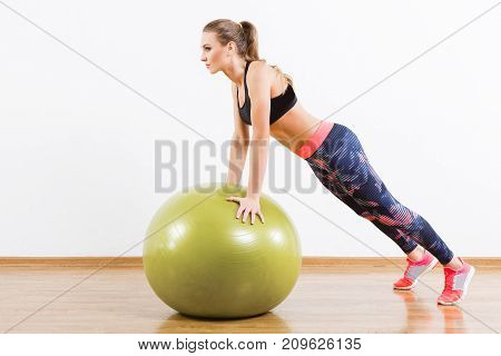 Attractive Girl Doing Physical Exercises With Fitball At Gym