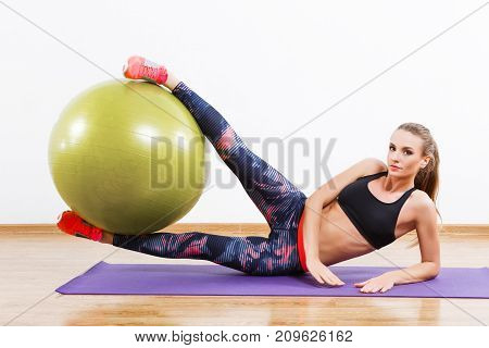 Cute Girl Doing Physical Exercises With Fitball At Gym