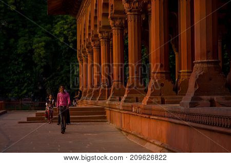 Jaipur, India - September 19, 2017: Unidentified man walking inside of Muslim architecture detail of Diwan-i-Am, or Hall of Audience, inside the Red Fort in Delhi, India.