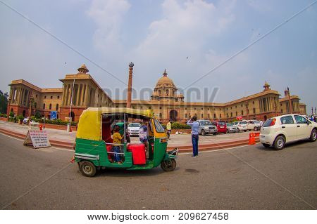 Jaipur, India - September 26, 2017: Beautiful goverment building of Rashtrapati Bhavan is the official home of the President of India, with some richshaw parked at outdoor, fish eye effect.