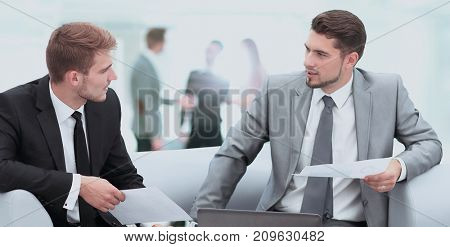 Business people Having Meeting Around Table In Modern Office