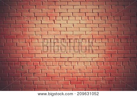 Red brick wall texture grunge background with vignetting