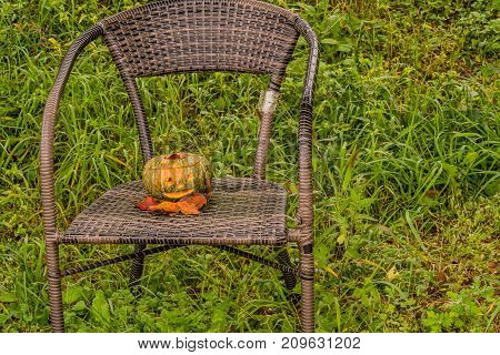 Jack-o-lantern On Chair In Park