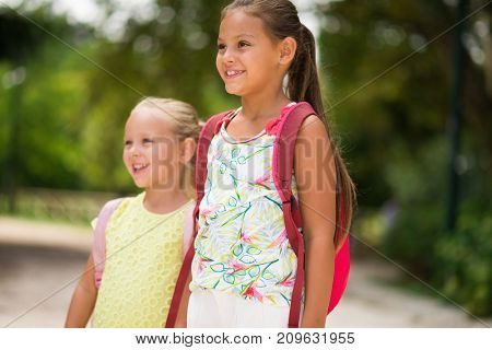 Little girls going to school together