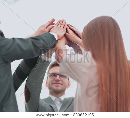 Image of business partners hands on top of each other symbolizing