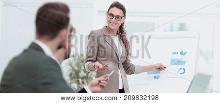 Successful  Woman making a business presentation to a group