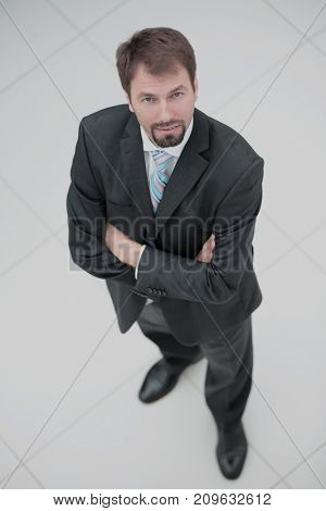 Happy middle aged man  standing and looking at camera. Top view.