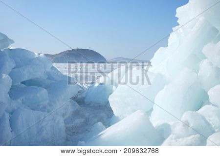 Huge blocks of ice in the sea close up