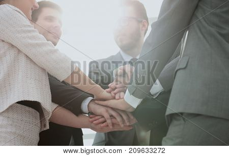 success concept: friendly business team standing in a circle and