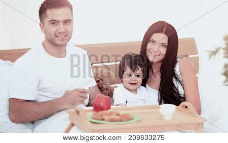 Smiling family having breakfast