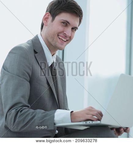 Handsome smiling confident business man portrait