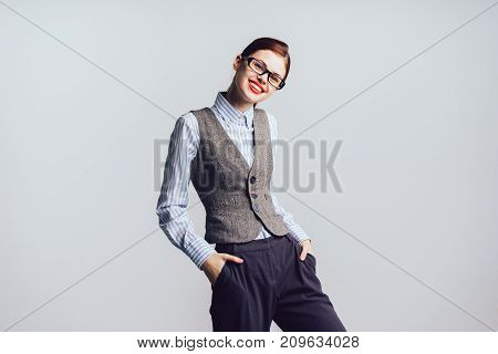 girl with glasses and with red lips laughs and looks at the camera, isolated