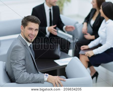 Portrait of business man  looking at camera on the background of