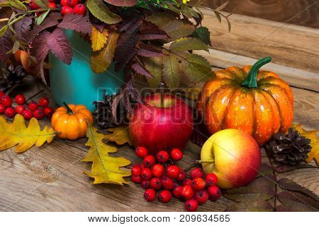 Thanksgiving Arrangement With Rowan, Pumpkin And Turquoise Vase