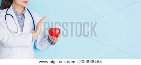 Young Professional Doctor Woman Holding Heart