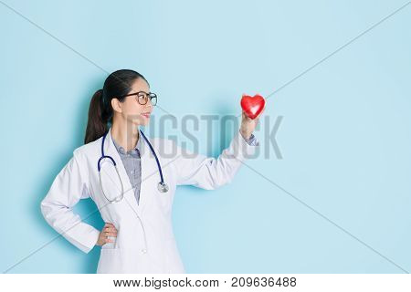 Professional Female Doctor Looking At Heart
