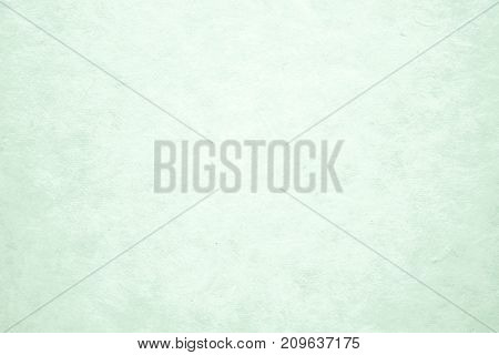Blank green paper texture background detail close up