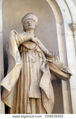 LUCCA, ITALY - JUNE 03: Saint Donatus on the facade of Santi Paolino e Donato church in Lucca, Tuscany, Italy on June 03, 2017.