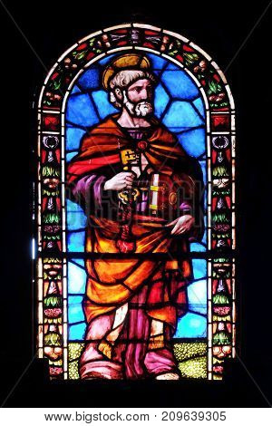 LUCCA, ITALY - JUNE 03: Saint Peter, stained glass window in the Santi Paolino e Donato church in Lucca, Tuscany, Italy on June 03, 2017.