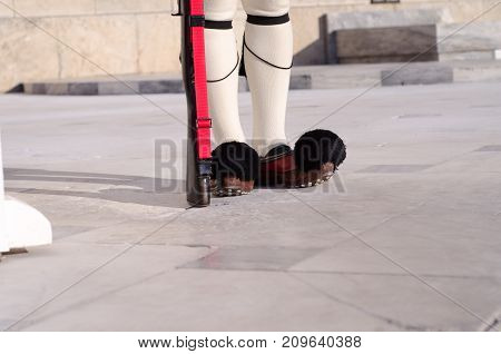 Tsolias or known as Evzones is Greeces historic presidential guard Syntagma.Tsarouhi is a type of shoe which is typically known as part of the traditional uniform by the Greek guards