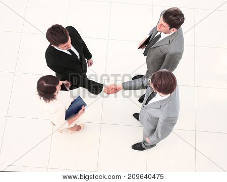 Group of successful business people shaking hands. Top view.