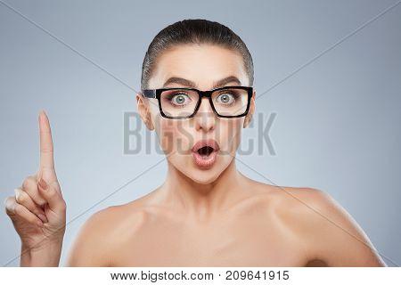 Beauty Portrait Of Woman In Glasses Having Idea