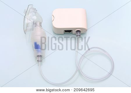 Assembled portable medicine inhaler. White inhaler flat view from above.