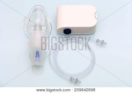Portable inhaler on table. Details of new handle inhaler.
