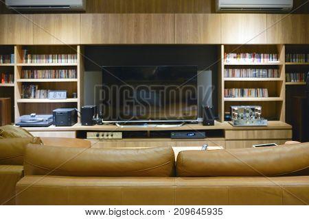 Sofa in front of TV shelf cabinet mock up design
