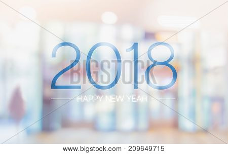 Happy New Year 2018 Word On Blur Pale Color Convention Hall Office Building Bokeh Background.