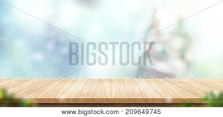 Empty Wooden Table With Abstract Blur Christmas Tree And Snow Falling Background With Bokeh,holiday